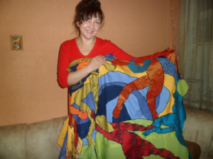 Lyuda sews CurtainArt at home . She can decide her own hours and wage and is part of the creative proces as a co-artist